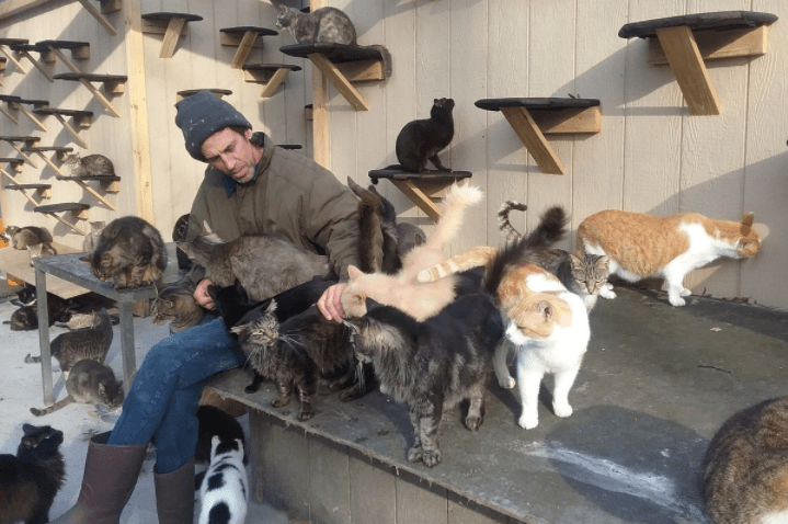 Chris Arsenault inside the cat sanctuary he made for his son that now has the best conditions for over 300 cats.