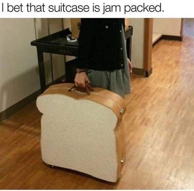 Suitcase that looks like two slices of bread pun captioned that it is JAM PACKED