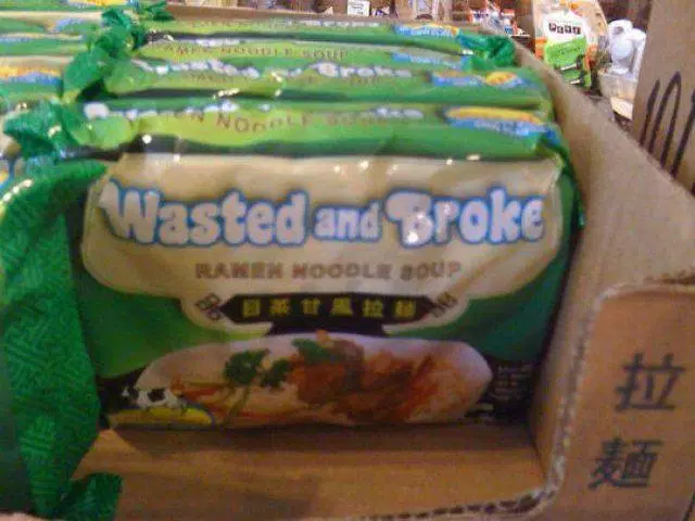 "funny photo of ramen noodle package that says ""wasted and broke"" on it."