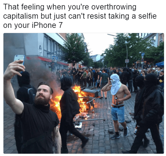 Funny meme about protester taking selfie in the middle of a protest.