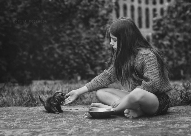 Girl playing with cat.