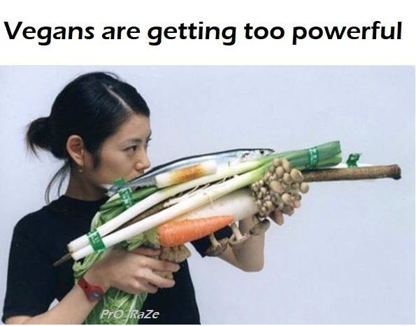 Funny meme about vegans getting too powerful, gun made out of vegetables.