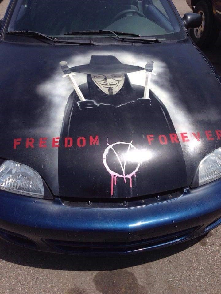Cringeworthy mural painted on a cheap car