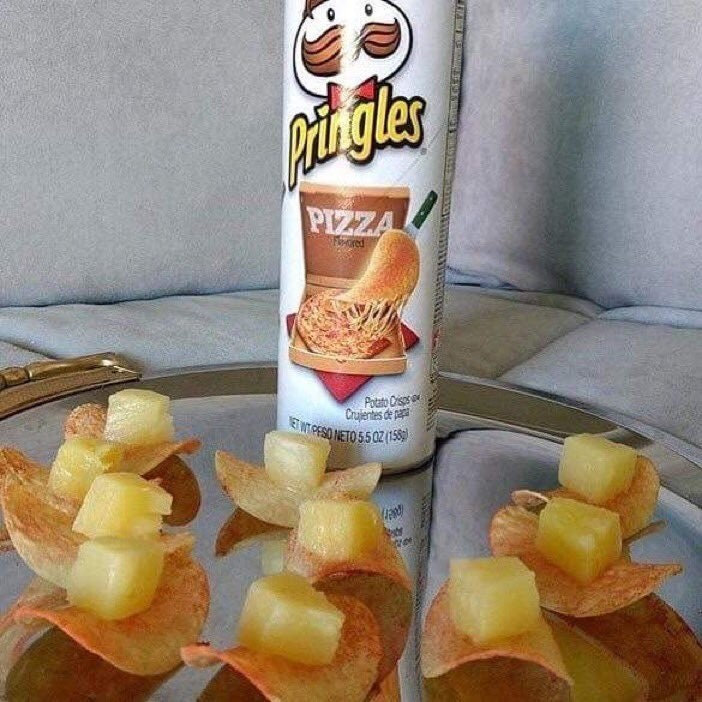 Horrible photo of pineapple chunks on pizza flavored pringles.