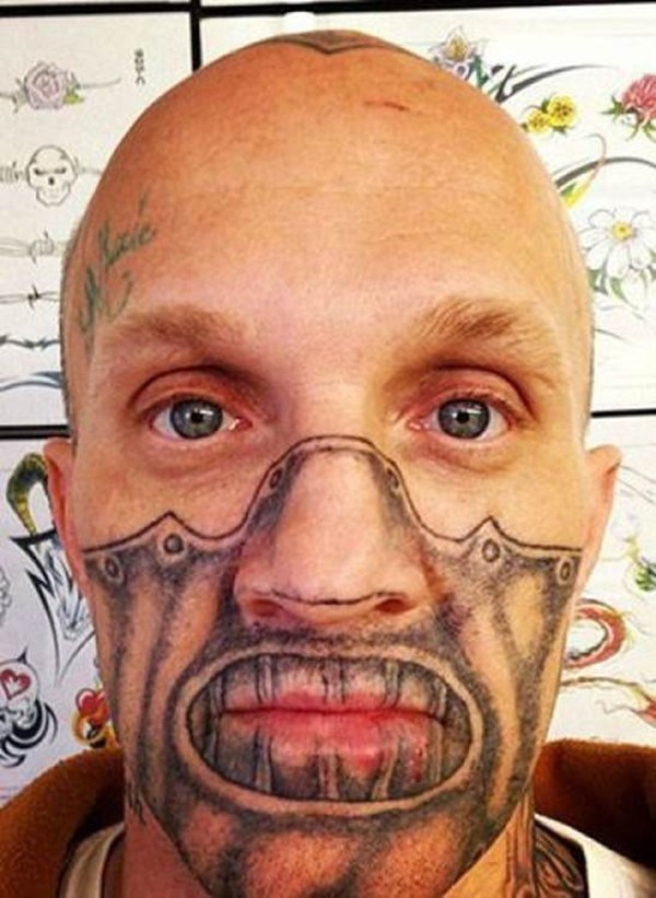 Mean muzzle looking facial tattoo