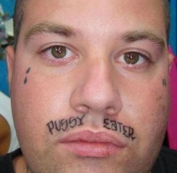 Man with crass tattoo on his face