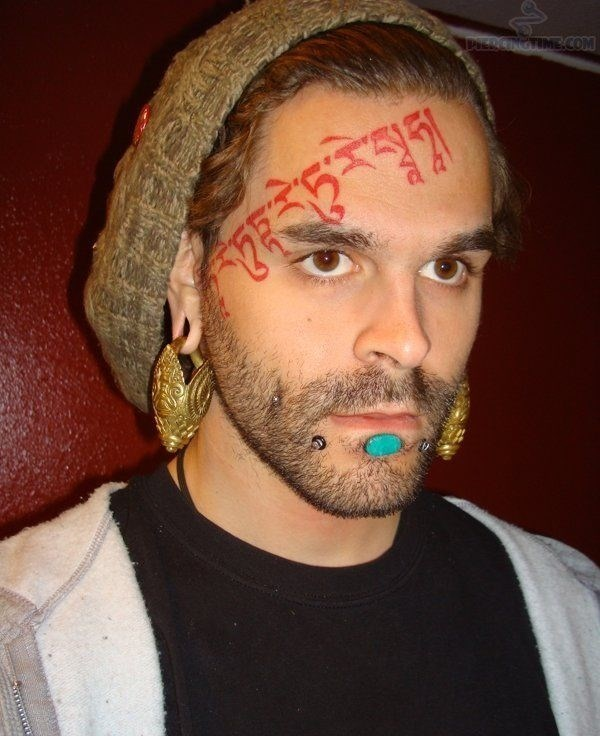 diagonal pattern face tattoo
