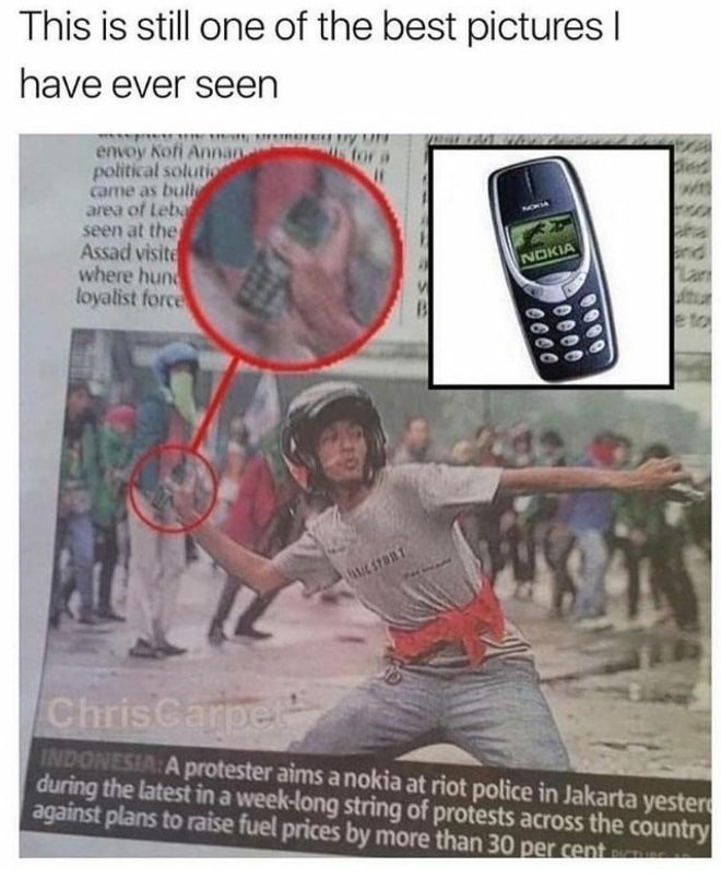 Photo of a riot on a newspaper in which protester is throwing an old nokia brick phone.