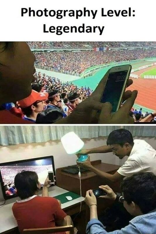 High level photography hack of playing with your phone at the game, but is is just computer screen and a friend holding up a lamp