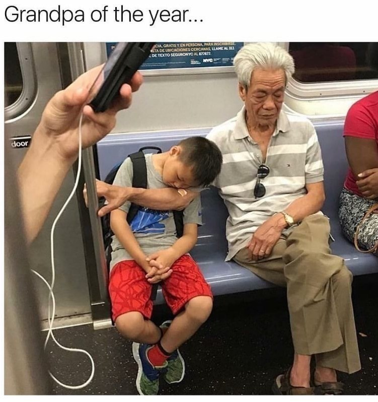 Meme of Grandpa of the year holding up the grandson's head with his arm holding the pole.