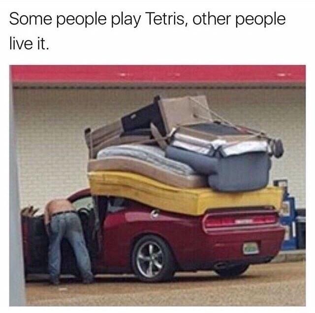 Man loading his furniture Tetris style onto his sports car