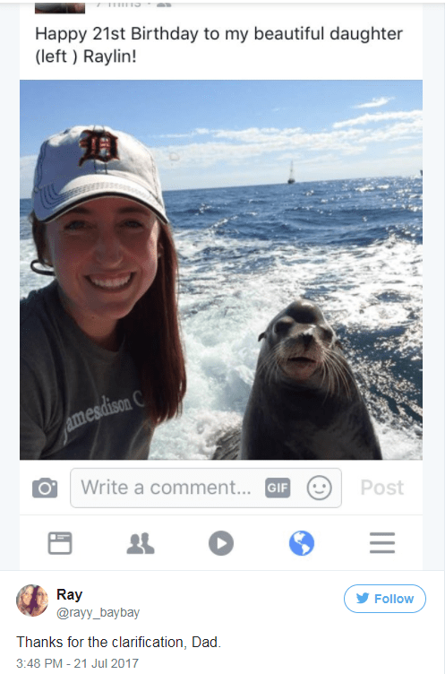 Tweet from dad to Raylin Pellatt of his daughter and a sea lion, with clarification which one she is.