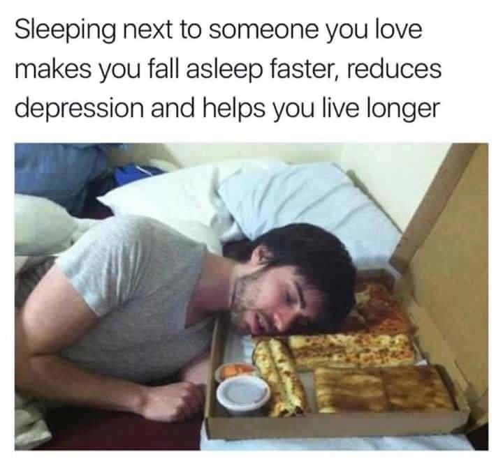Funny meme about how sleeping next to someone you love makes you happier and helps depression, photo of man sleeping next to pizza and bread sticks.