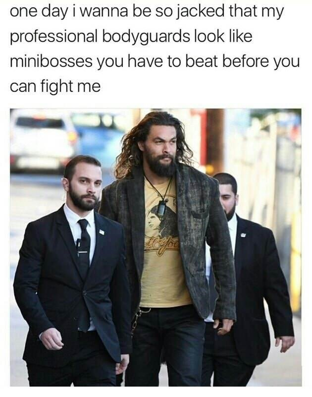 One day meme of Jason Momoa looking super jacked while walking with his body guards
