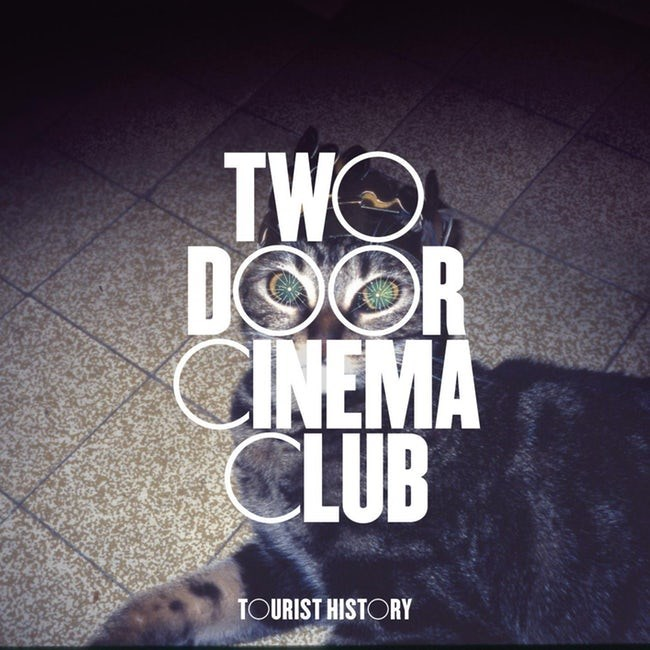 album cover - Text - TWO DOOR GINEMA CLUB TOURIST HISTORY