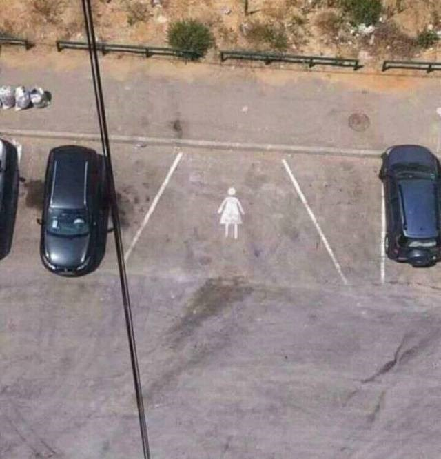 inappropriate meme about women parking a car