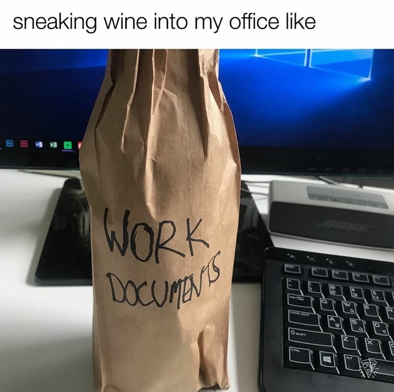 Wine bottle wrapped in brown paper and marked WORK DOCUMENTS to sneak it into the office.