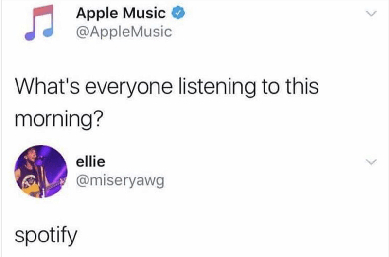 Tweet by Apple Music asking what everyone is listening to this morning and @miserawg says Spotify, in epic burn.