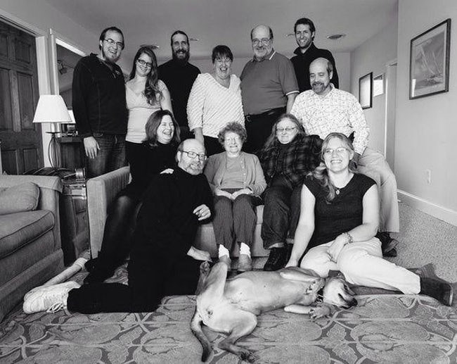 Family photo sort of ruined by dog spread-eagle on the floor in the foreground.