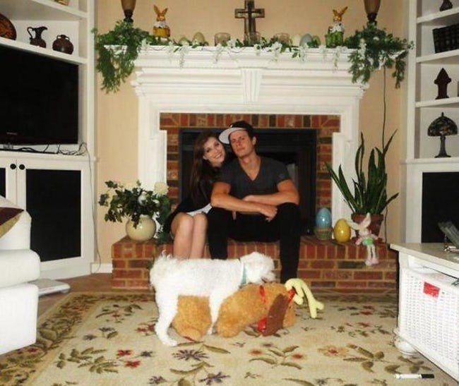Humping dog ruins cute couple pic