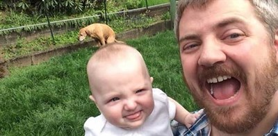 Pooping dog ruins cute father-daughter selfie