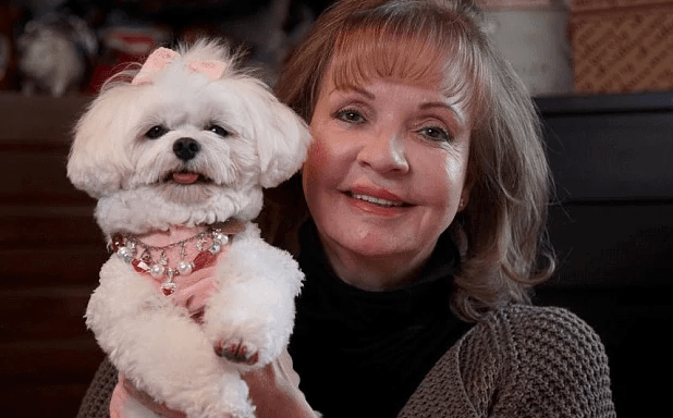 Leona Helmsley with Trouble, the Maltese dog she left $12 Million for in her will.