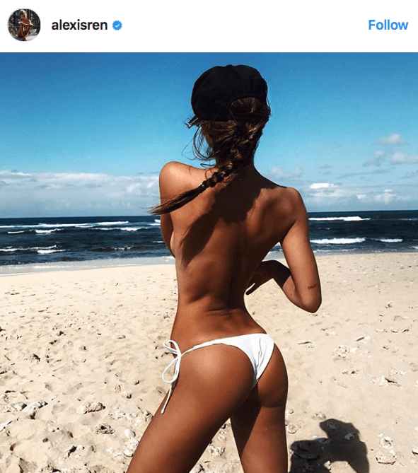 another instagram pic of Alexis Ren on the beach, wearing only Bikini bottom