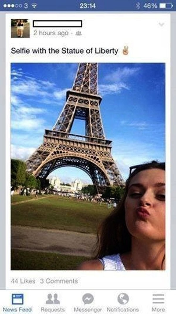 Facebook post of woman posing with Eiffel tower saying it is the Statue of Liberty.