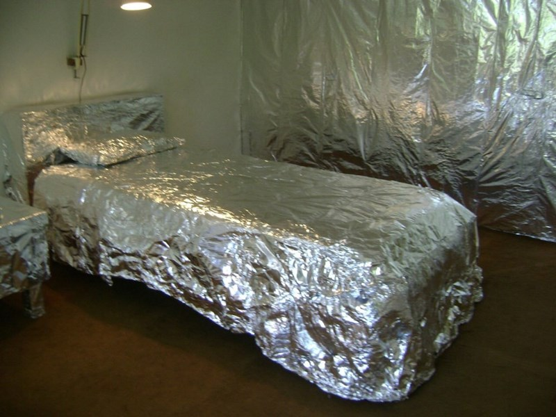 cursed image-bedroom completely covered in aluminum foil