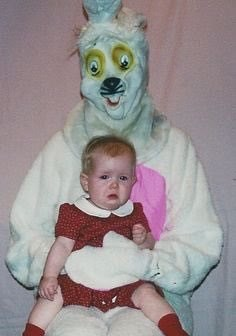 cursed image-baby held by someone in a creepy costume