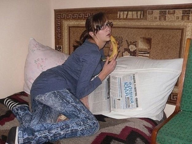 cursed image-girl posing with a banana on a bed