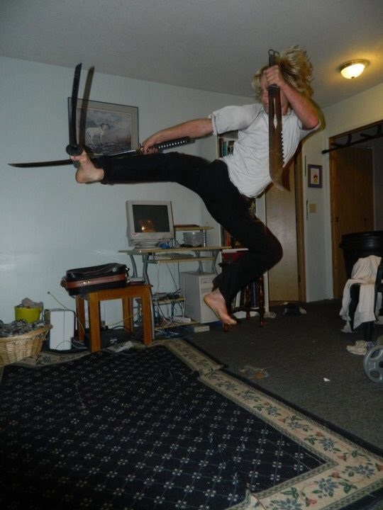 cursed image-guy jumping in the air with knives help in between his toes and hands