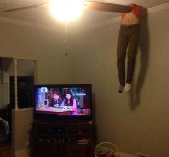cursed image-man coming out of a ceiling