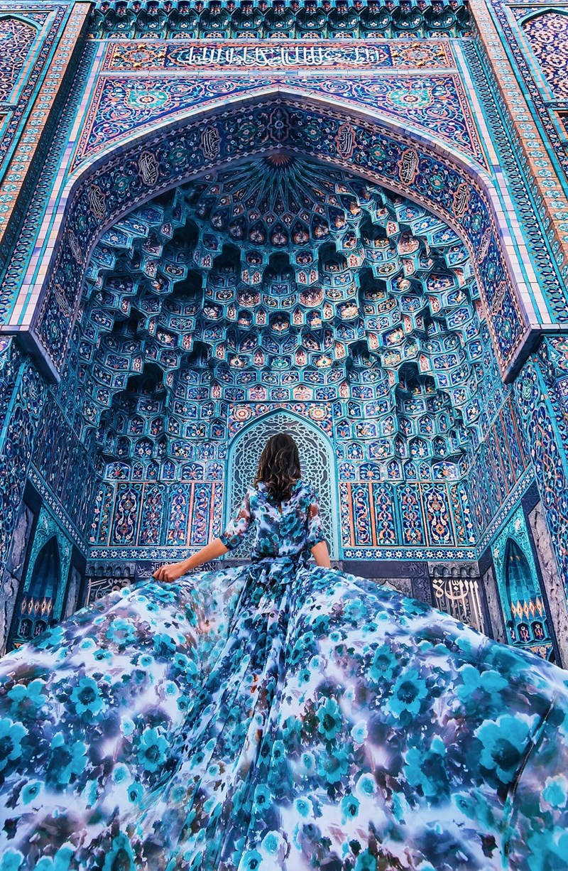Blue dress outside a blue cathedral