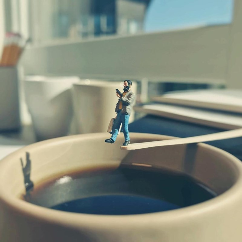 Man walking off a plank into the coffee cup.