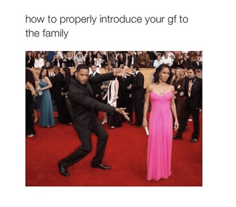 Will Smith gestures to present and introduce his lovely wife, Jeda on the red carpet, with caption that this is how to properly introduce your GF to the family.