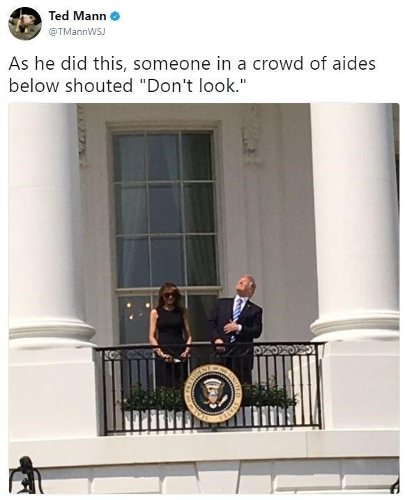 Tweet by Ted Mann of Trump looking at the eclipse while someone from the crowd yelled DON'T LOOK