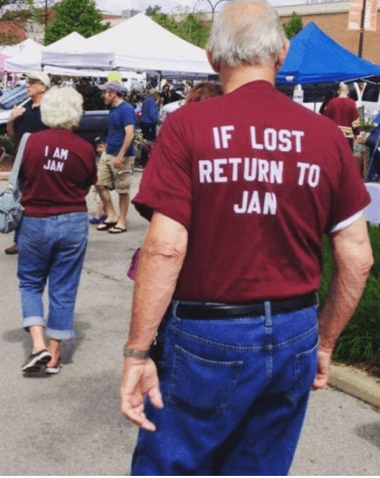 Husband with shirt to return him to Jan if lost, with Jan wearing the shirt