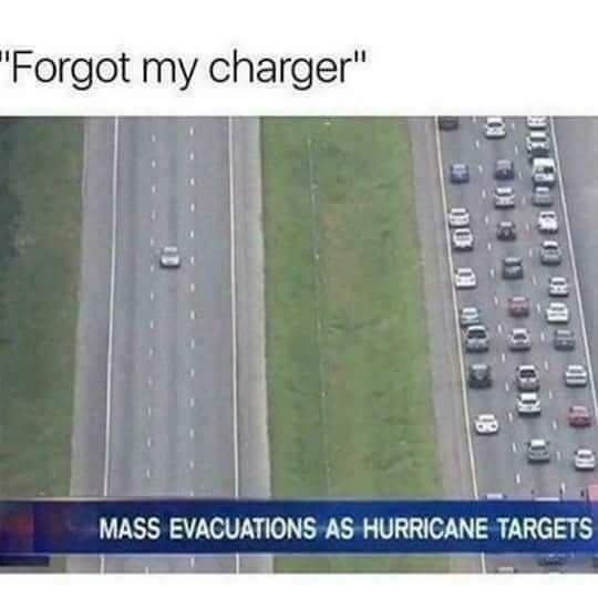 Funny meme about ignoring an evacuation when you forget your phone charger.