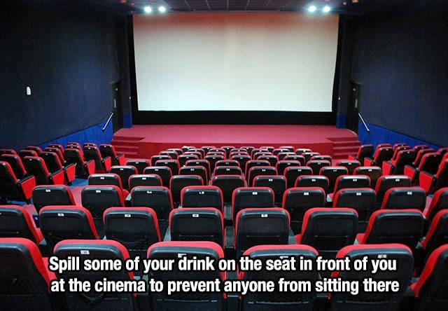 empty cinema room with red seats and blank white screen life hack meme