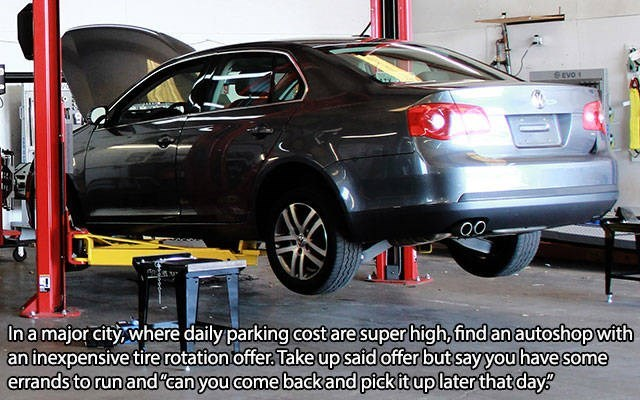 silver car lifted off ground in mechanic's workshop life hack meme