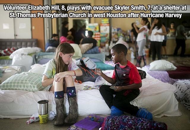 Community - Volunteer Elzabeth Hill, 8, plays with evacuee Skyler Smith, 7,atashelterat St.Thomas Presbyterian Church in west Houston after Hurricane Harvey Mart Sot