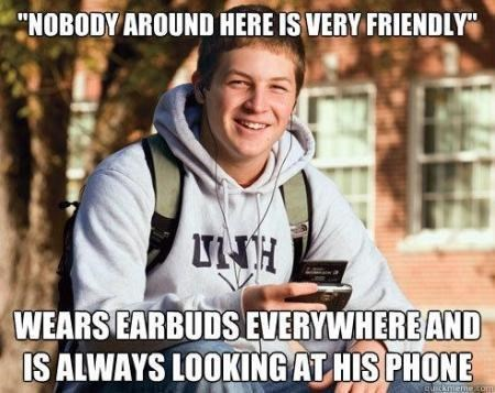 """Photo caption - """"NOBODY AROUND HERE IS VERY FRIENDLY H WEARS EARBUDS EVERYWHERE AND IS ALWAYS LOOKING AT HIS PHONE Suckiemec"""