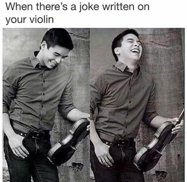 Funny meme about a photo of a man laughing at his violin, silly stock photo.