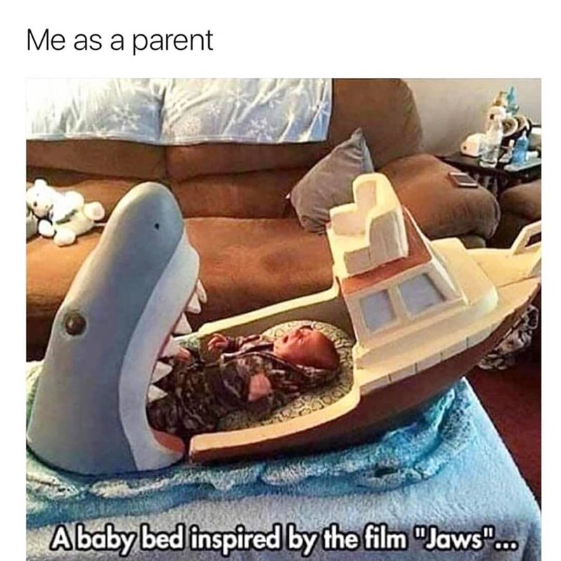 Funny meme about a baby bed that looks like a scene from jaws with the shark.