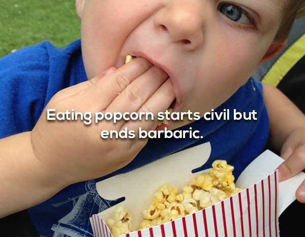 Eating - Eating popcorn starts civil but ends barbaric.
