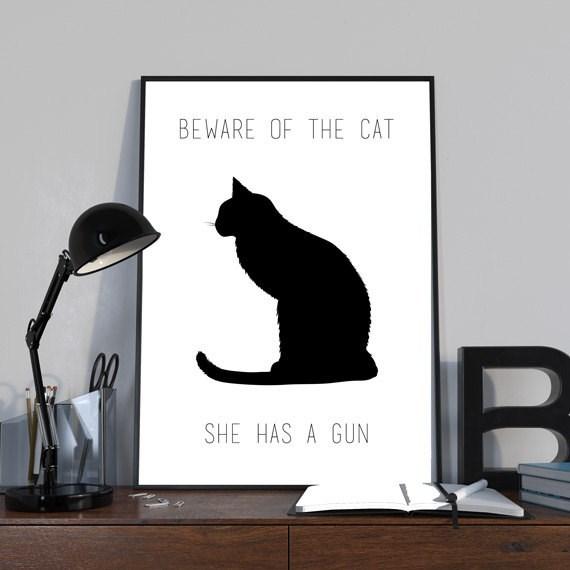Cat - BEWARE OF THE CAT SHE HAS A GUN