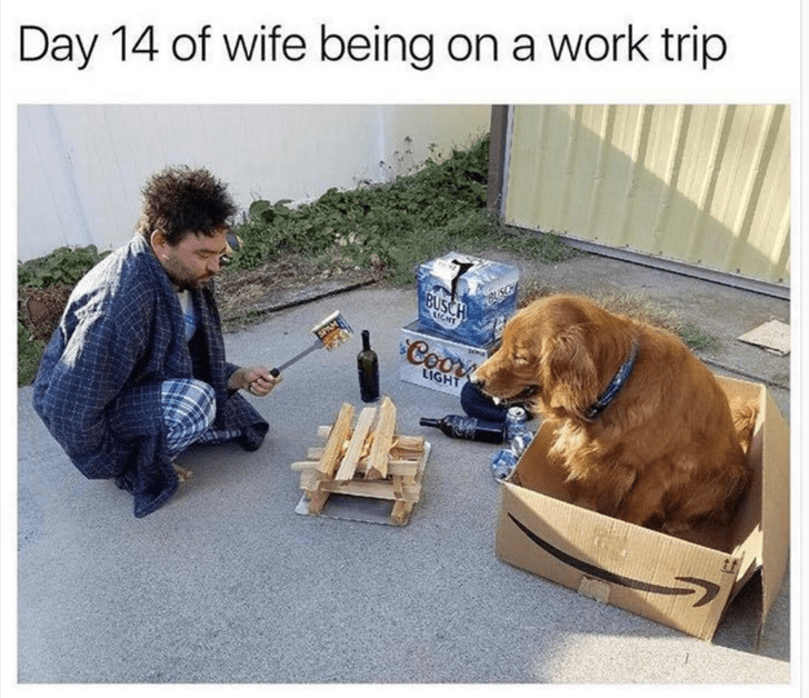 meme about husband being useless when wife is away with picture of man in robe roasting can over fire next to dog in Amazon box