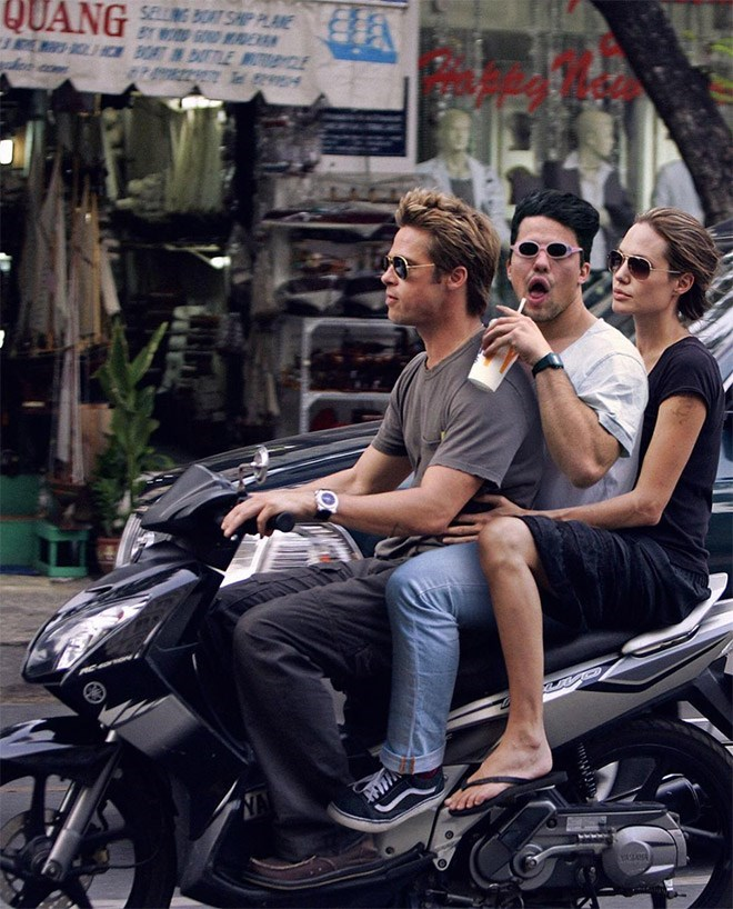 Average Bob photoshopped into pic of Brad Pitt and Angelina Jolie on a scooter bike.
