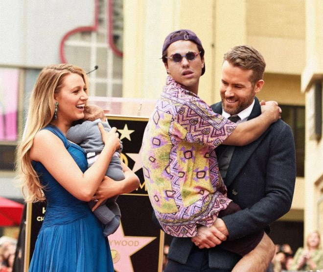 Average bob holding on to Ryan Reynolds like he is his daddy.